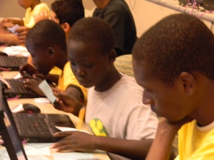 Fugees working on digital storytelling project, Summer 2011